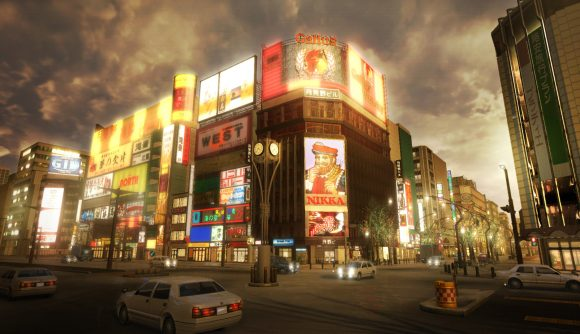 A Tokyo city street corner, covered in neon signs and advertising