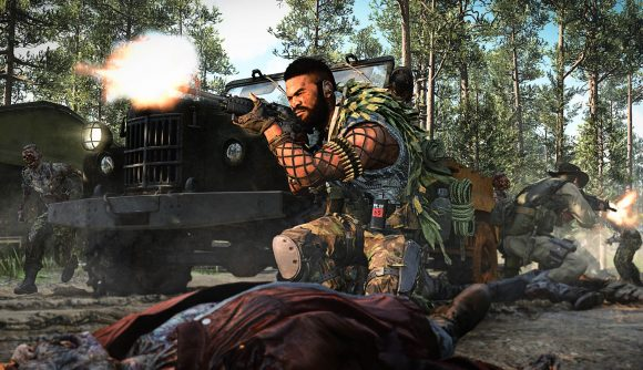 A man crouches in Call of Duty: Cold War's Outbreak mode and shoots into a horde of zombies