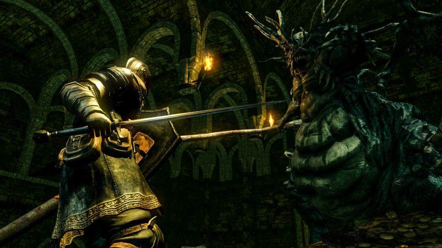 De baas vecht tegen het Demon Asylum in Dark Souls Remastered