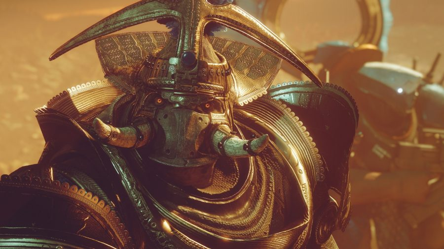 Destiny 2's Caiatl, Empress of the Cabal, stares defiantly at the camera, her orange eyes aglow and her ornate headress and golden armour lit by a fiery sun