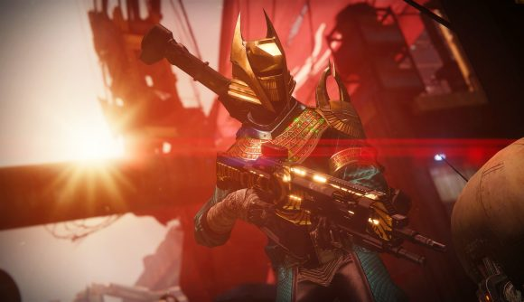 One of Destiny 2's Warlocks holding a Trials of Osiris gun while the sun shines behind them