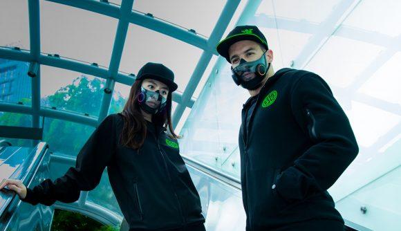 Two people wearing Razer's prototype RGB-clad face mask