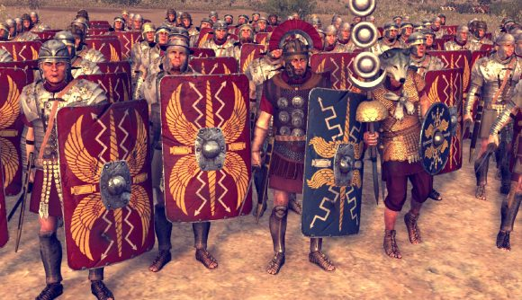 A centurian stands flanked by imperial-era roman legionnaries