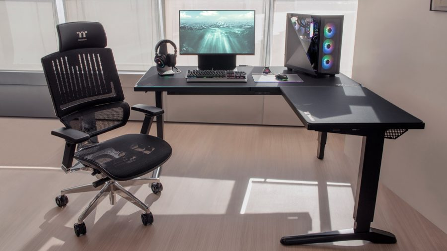 Thermaltake's height adjustable L-shaped ToughDesk 500L holds a monitor and a gaming PC on top of it