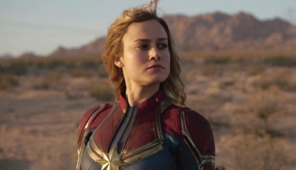 Brie Larson as Captain Marvel looking pensively off camera in a shot in a desert