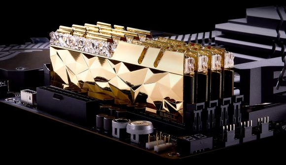 Four gold G.Skill Trident Z RGB Royal Elite DDR4 RAM modules sit in a motherboard