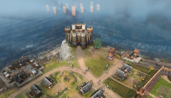 A keep on a hill looking out over the sea in age of empires 4 as a fleet of ship approaches