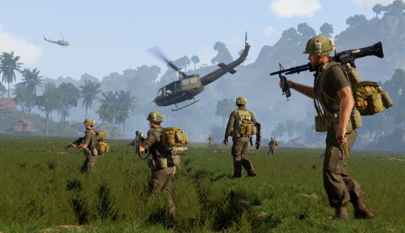 Four american soldiers marching across a field in Arma 3 Vietnam, a helo takes off in the distance