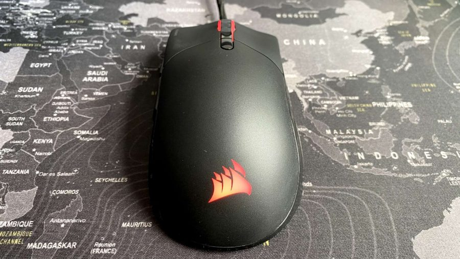 A front view of Corsair's mouse on a mouse pad, with red RGB lighting set