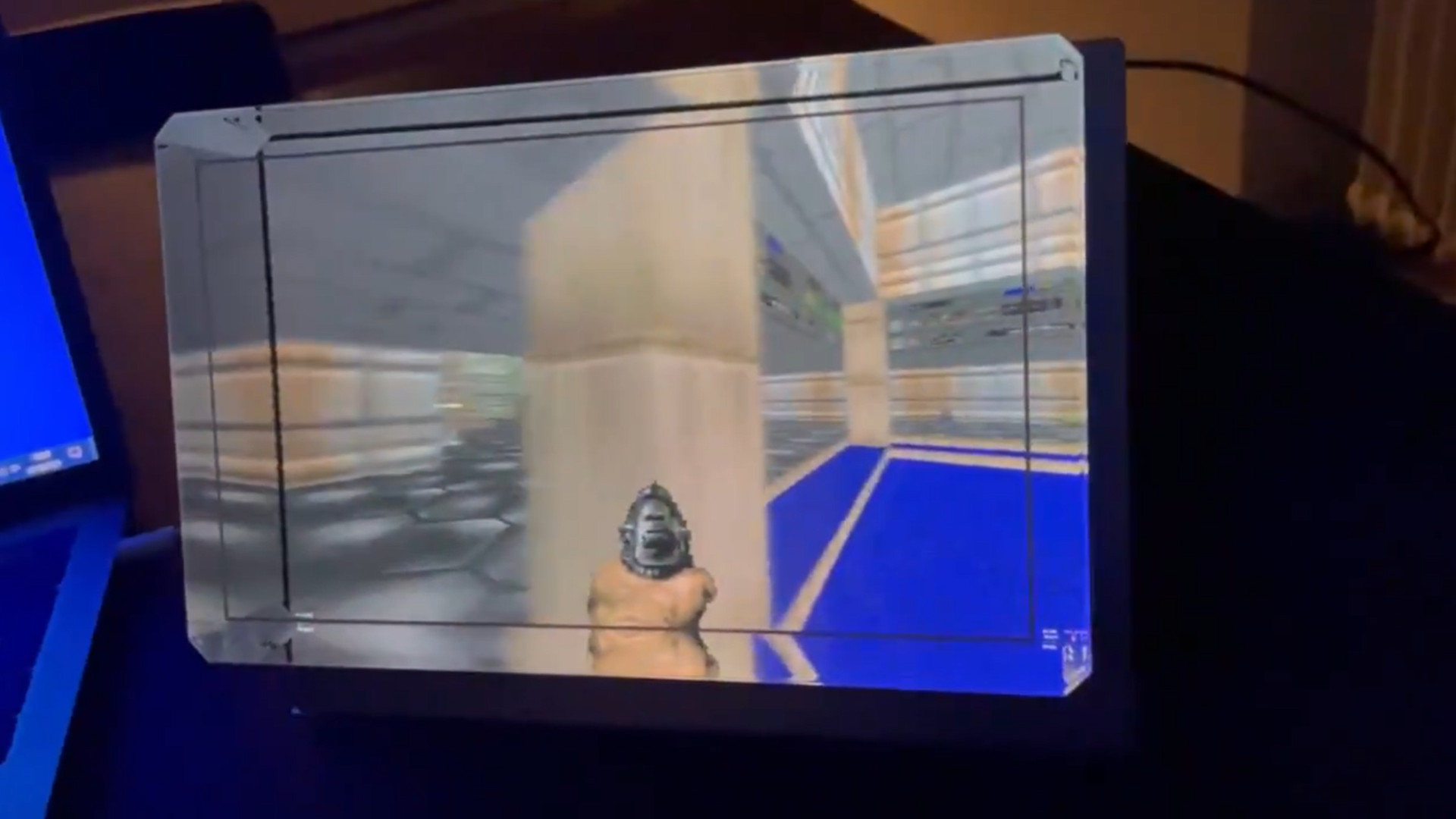 Here's Doom on a holographic display, so you can literally peek around corners