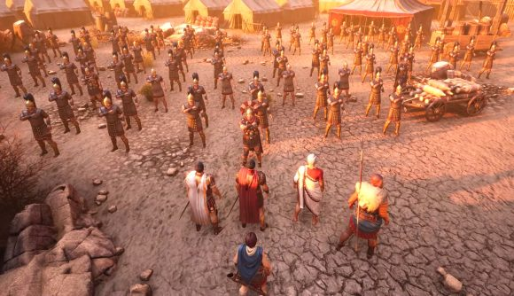 A roman officer and companions face a parade of legionaries making a salute
