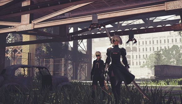 2B and 9S walk through the wreckage of Nier: Automata
