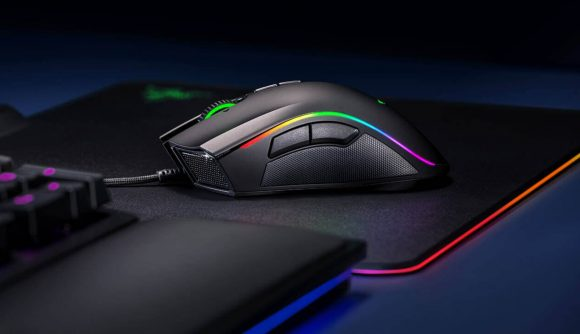 Razer's Mamba Elite gaming mouse sits on an RGB mouse pad next to a gaming keyboard