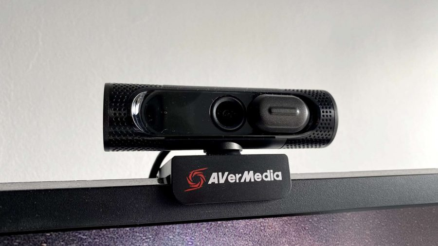 Avermedia's black webcam placed upon a thick-bezelled monitor