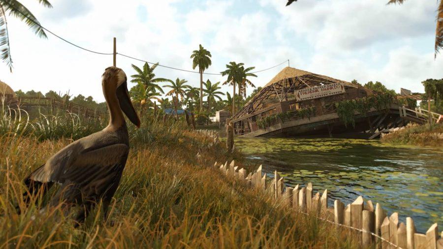 Ресторан тонет в болоте острова в Far Cry 6, а местная птица печально смотрит на него.