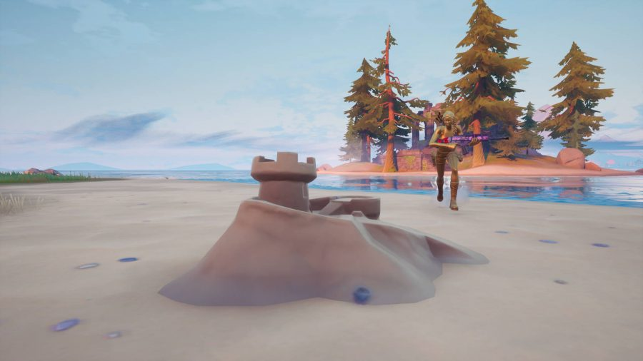 A gold Lara Croft approaches one of the Fortnite sandcastles that need to be destroyed.