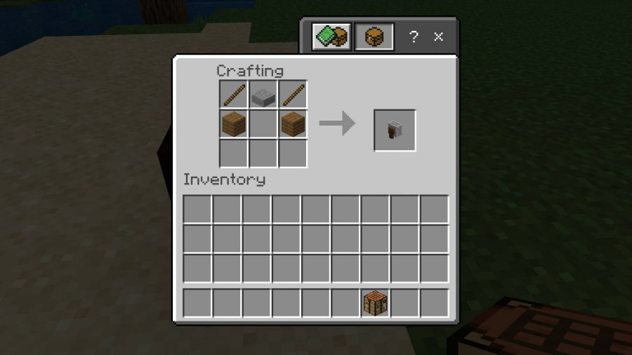 The recipe for crafting a Minecraft grindstone. It requires two planks, two sticks, and a stone slab.