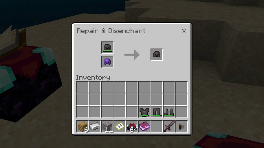 Using an enchanted helmet in a Minecraft grindstone with a damaged unenchanted helmet to make a new helmet.