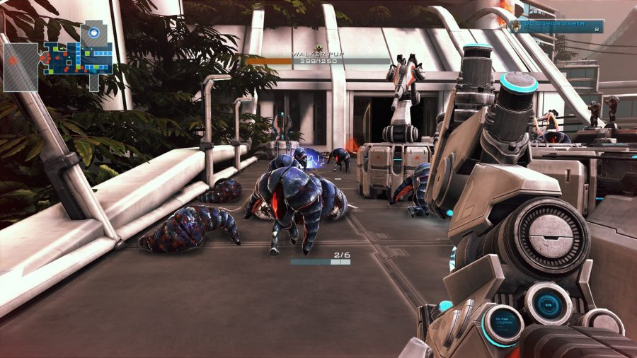 A swarm of small insectoid bipeds walking past gun turrets