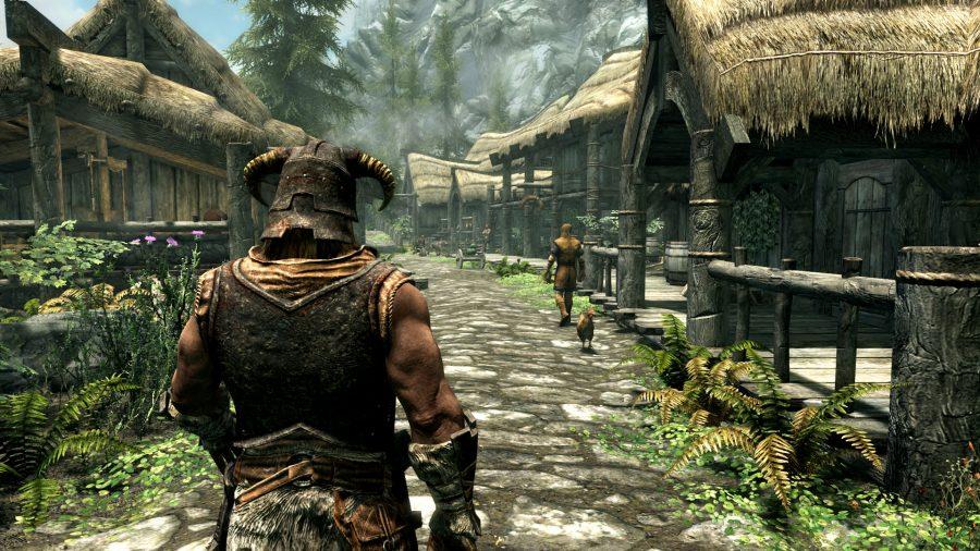 Dovahkiin walking through village in Skyrim