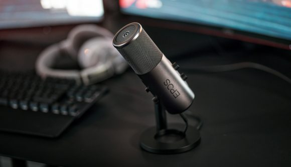 The new EPOS B20 gaming microphone sits on a desk pointed towards the user