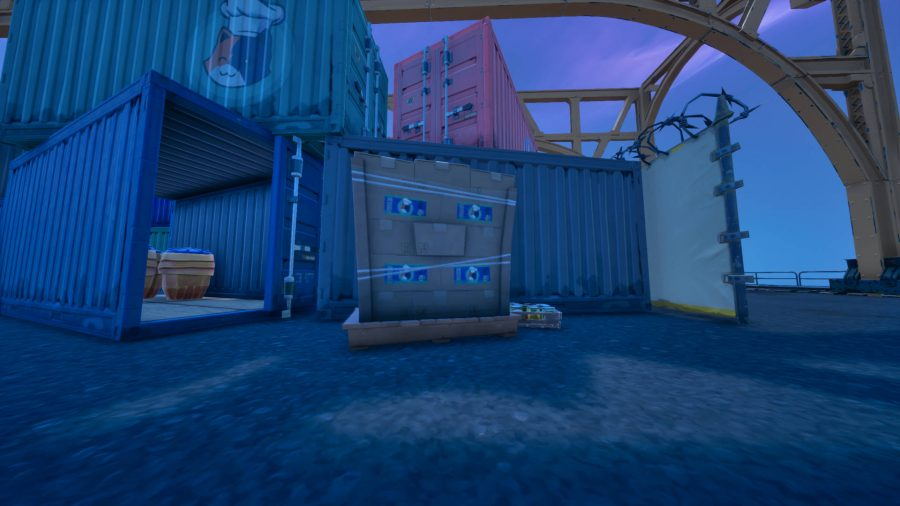 A batch of Fortnite cat food you can collect next to a container in Dusty Docks.