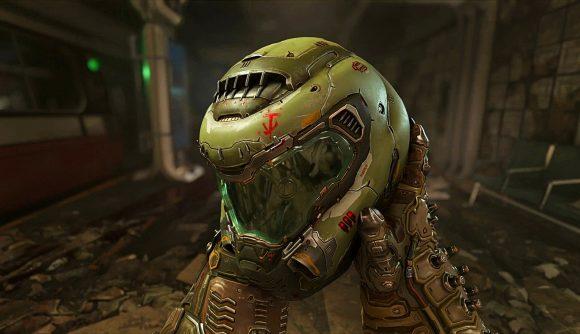 Doom guy looking at his helmet