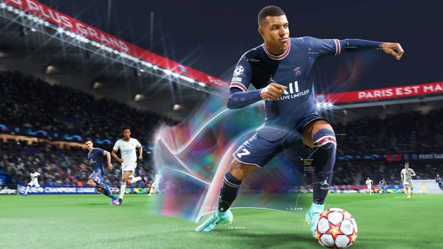 Kylian Mbappé, the FIFA 22 release date cover star, dribbling with the ball