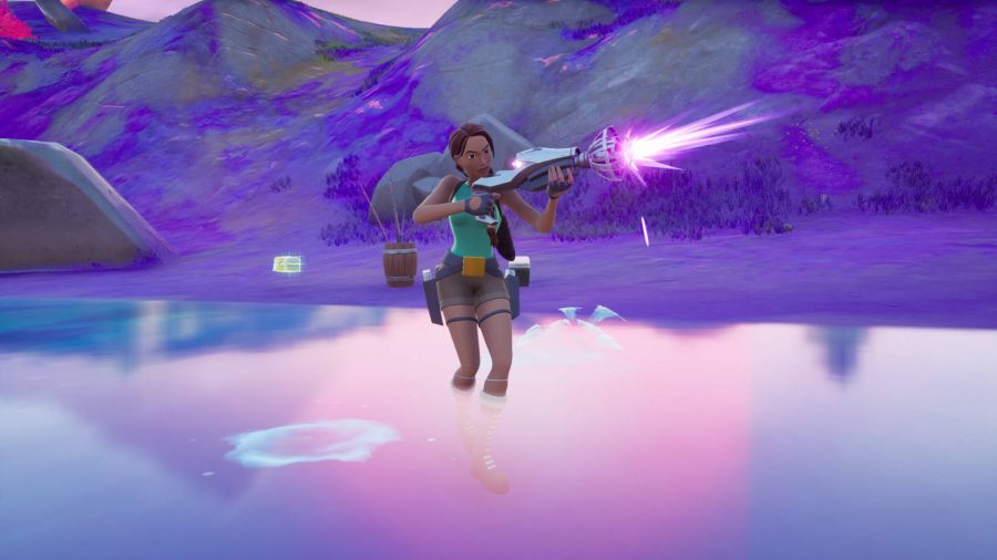 Lara is firing the Kymera Ray Gun, one of the four Fortnite alien weapons.