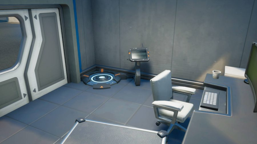 One of the Fortnite body scanners. It is a circular platform with a console attached to it.