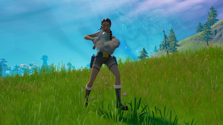 Lara is using a hammer to craft a new weapon in Fortnite.