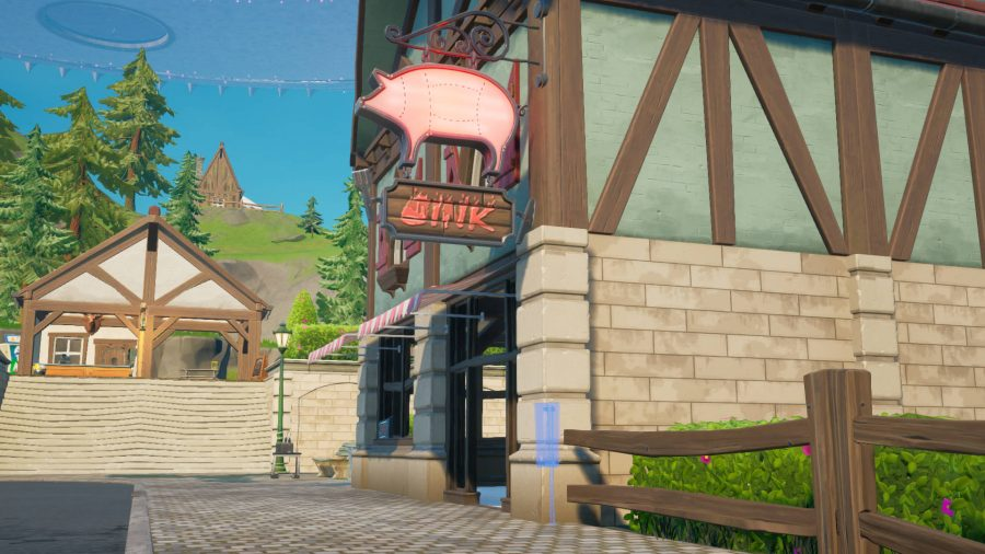 An outline for a Fortnite missing persons sign in Misty Meadows outside a butchers shop.