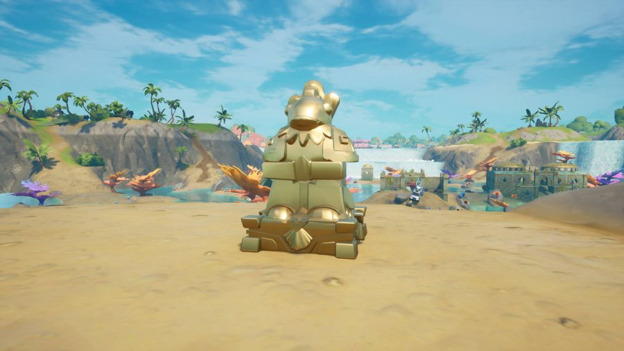One of the Coral Castle Fortnite artifacts is a gold fish statue.