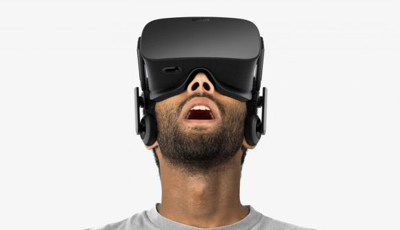 A man looking shocked with a VR headset on
