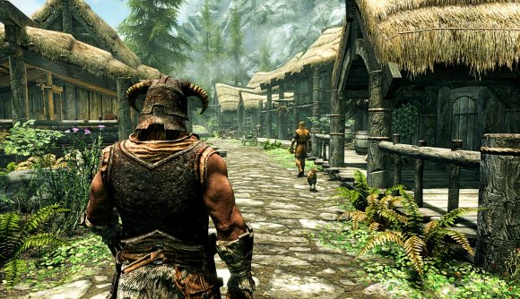 A character walking through a town in Skyrim