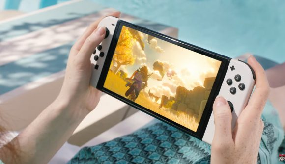 The new Nintendo Switch OLED playing The Legend of Zelda Breath of the Wild 2, with white joycons