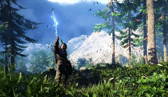A dark-haired warrior standing in a mountain forest holds aloft a sword that is infused with electric energy.