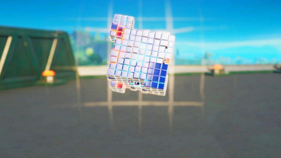 A shiny, glowing alien nanite cube in Fortnite