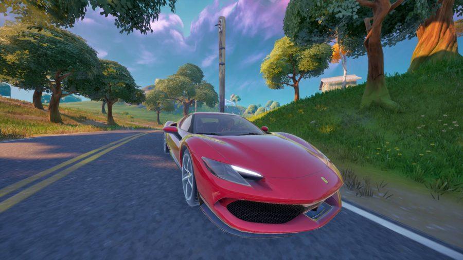 A red Ferrari 296 GTB driving down a road in Fortnite