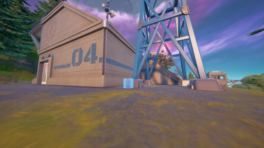 One of the outlines to plant wiretaps in Fortnite. It's at the base of a radio antenna.