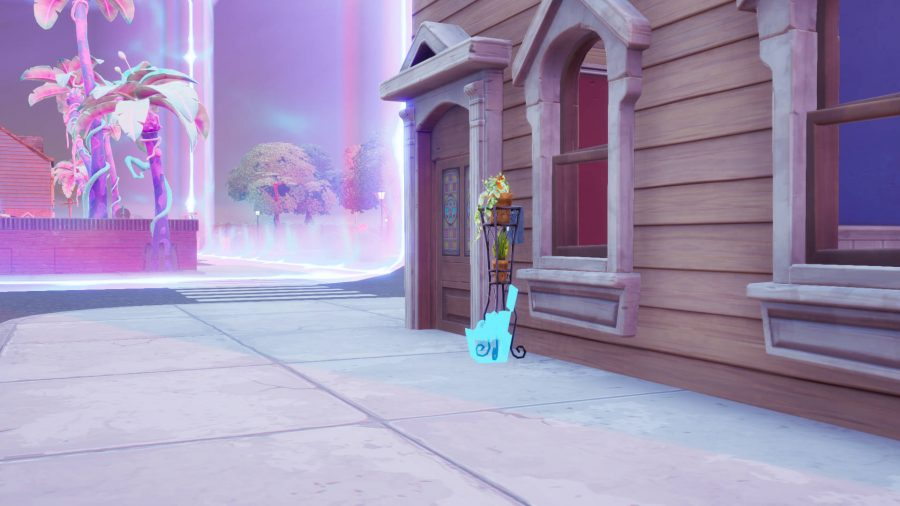 A Fortnite welcome gift package placed outside a house in Holly Hatchery. There is a purple anti-gravity field nearby.