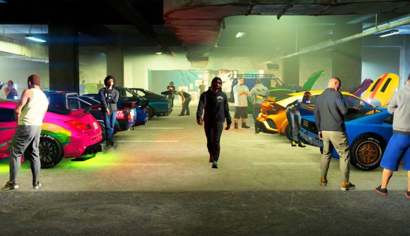 A view of the Grand Theft Auto V Los Santos Car Meet - a man surrounded by custom cars to the left and right of him