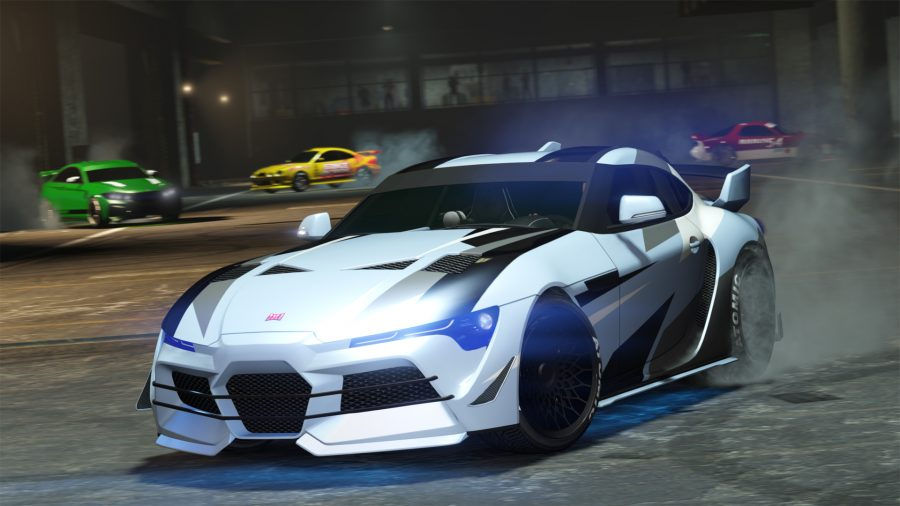 Cars race around a track in GTA V Online