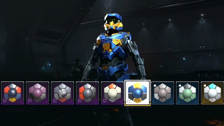 A Spartan standing wearing unique colours using Halo Infinite's armour customisation system