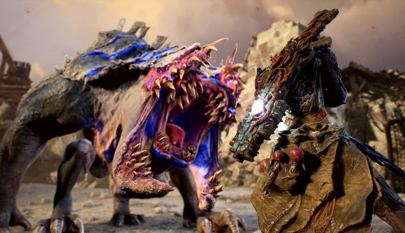 An Outrider faces off against a big, roaring monster that has compound jaws.