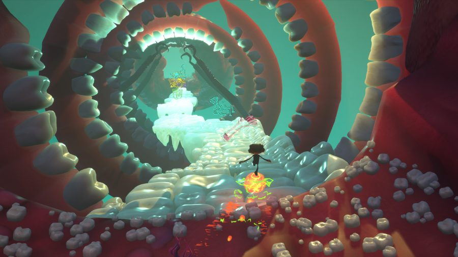 Raz of Psychonauts 2 sliding in a tunnel made of teeth