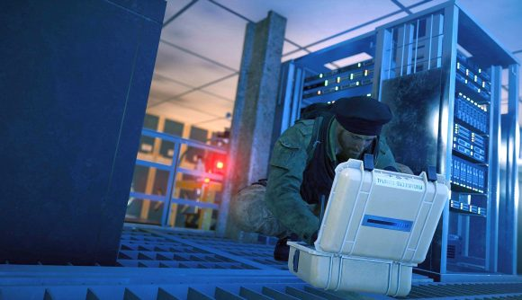 A Rainbow Six Siege operator crouches while prepping gear in a match