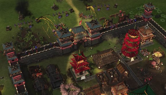 Catapults and rocket wagons fire missiles at a fortified castle in Stronghold: Warlords.