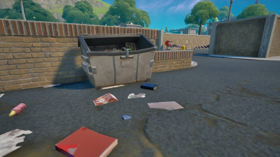 A book on explosives sitting by a dumpster in Dirty Docks in Fortnite. It's a blue book.