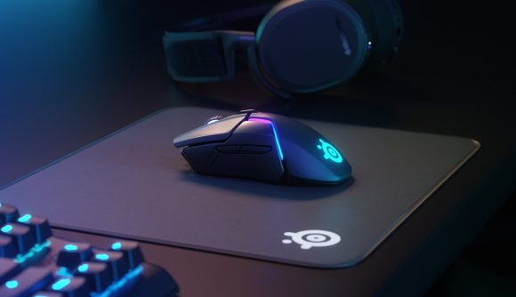 SteelSeries' Rival 650 wireless gaming mouse sits on a QcK mouse pad with no cables in sight
